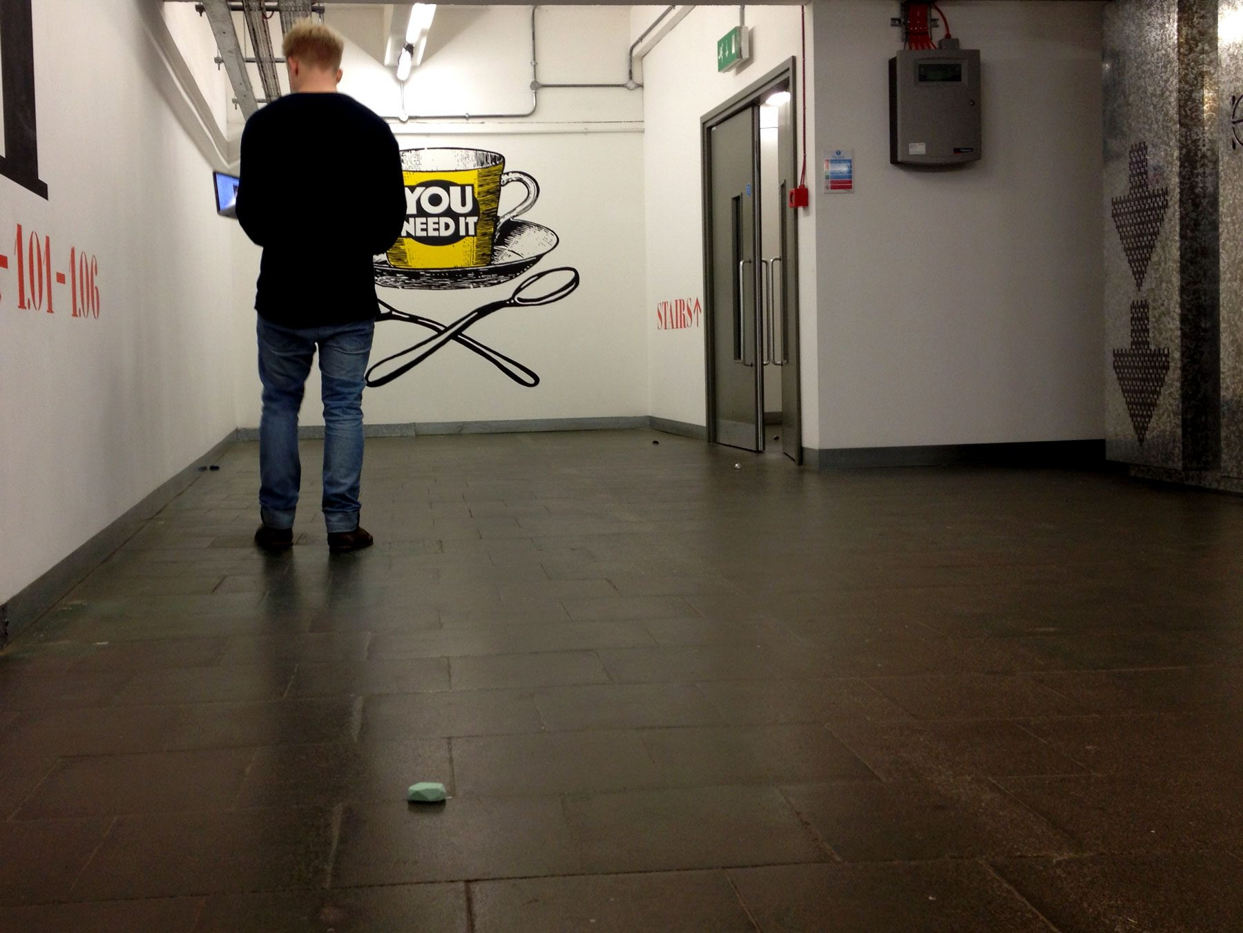 Man testing prototype of the iBeacon set up in a corridor