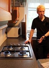 Tom from PGS Plumbers stood by gas hob