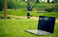 Image of laptop on grass