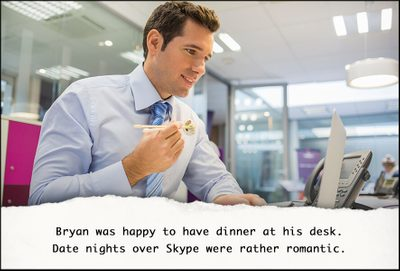 Employee eating dinner at his desk