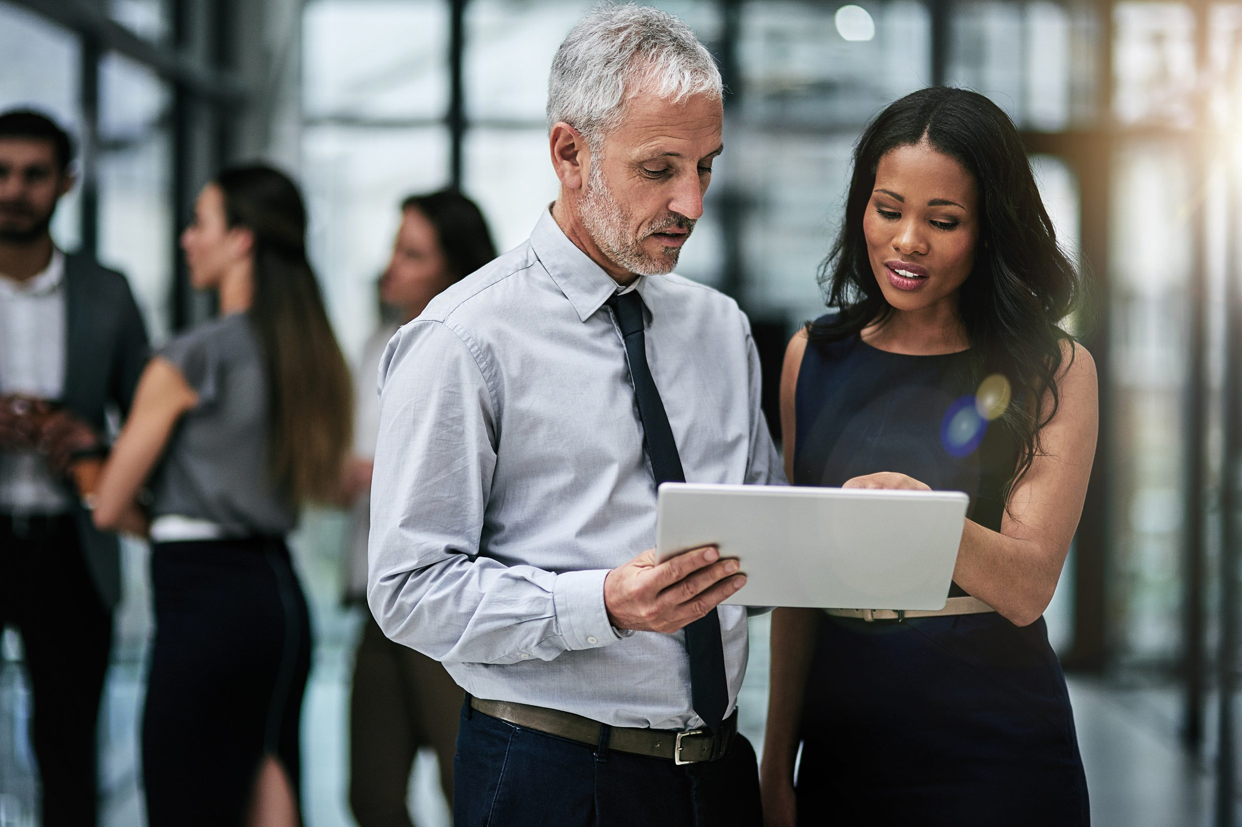 Two business people reviewing tablet