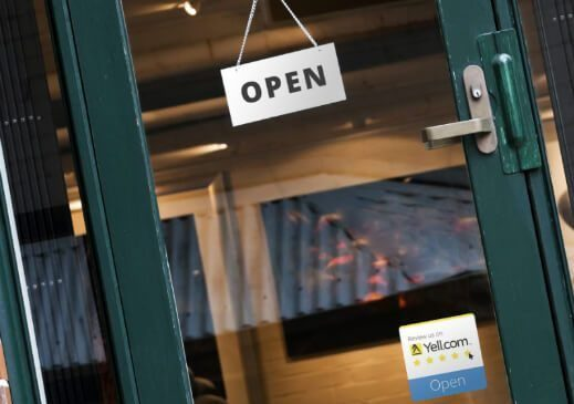 Yell.com review banner on shop door - open
