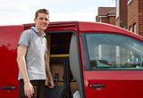 Man standing in front of a red van