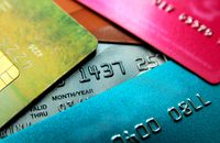 Stack of multicolored credit cards close-up view with selective focus.
