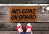 Welcome mat saying 'Welcome on board'