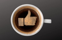 Cup of coffee with a like symbol on the surface