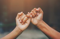 Image of two hands doing a pinky promise